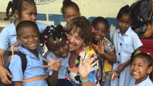 Giving Back - Elizabeth with the children of Zion Park School in Belize